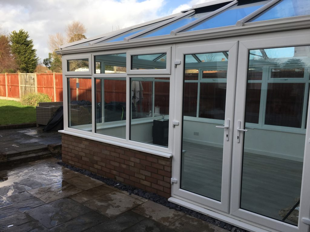 picture of a conservatory with views of the patio doors and view of the garden